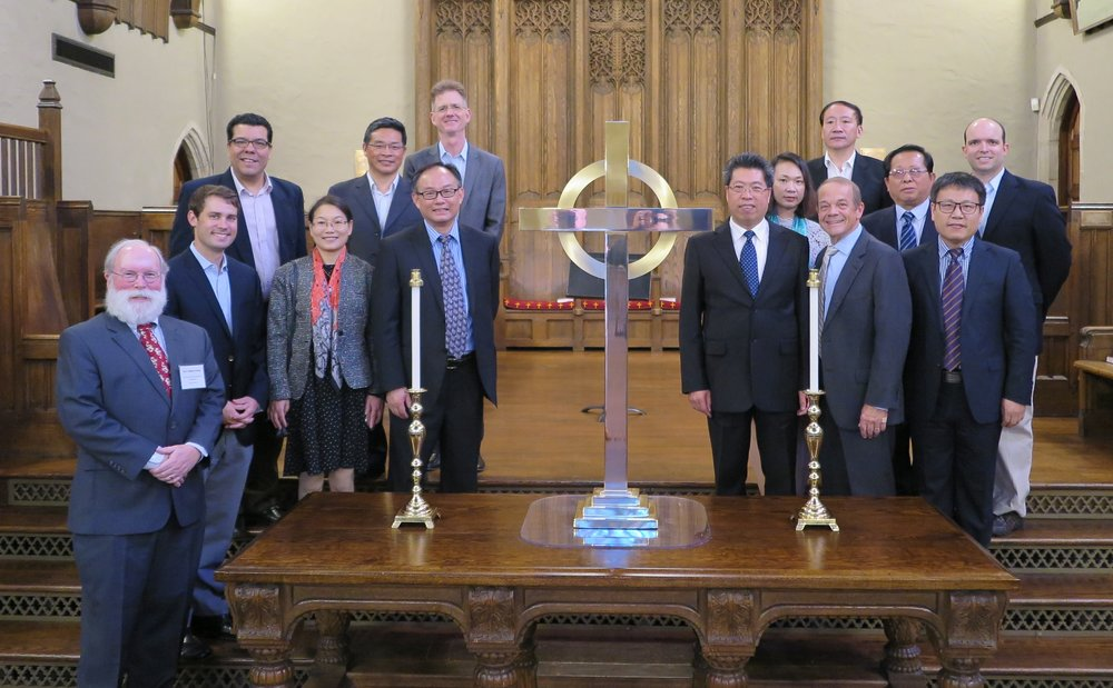Chinese delegation at First Presbyterian Church; Dr. Walt Conser, who led the host of helpers, far left; Rev. Shi Li, interpreter/helper throughout the trip, is immediately to the left of the cross.