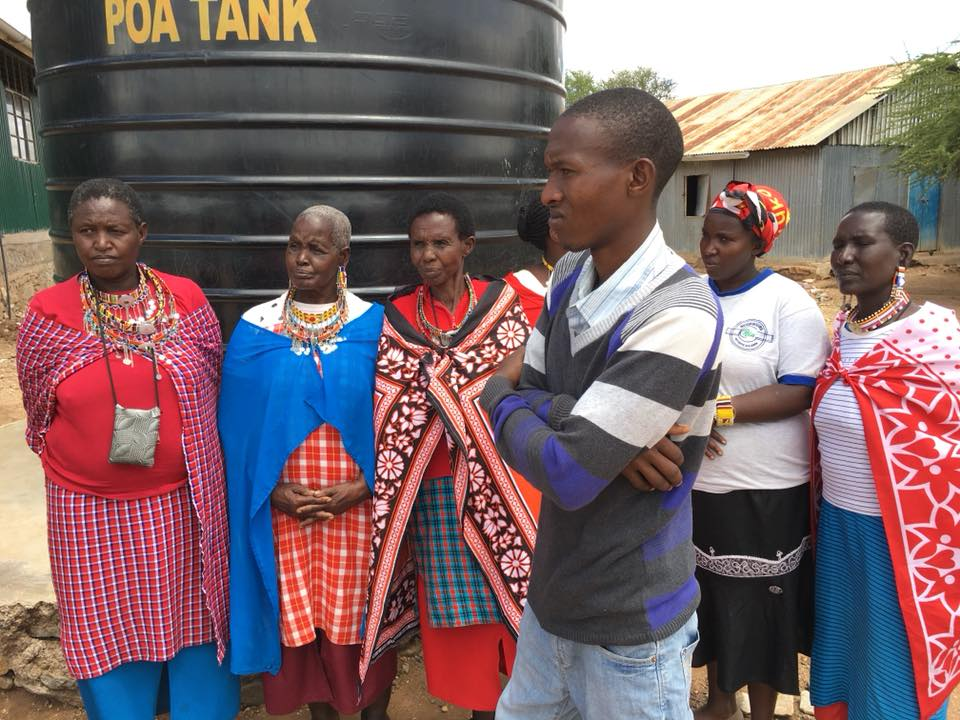 Maasai church worker Timothy Teto and ladies of the community.