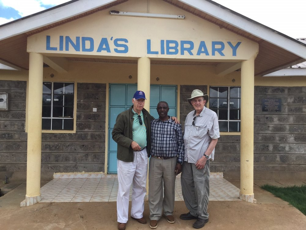 Stu Ross, Daniel G. Gakonyo, and Rob Weingartner at Grace GS library dedicated in memory of Stu's late wife, Linda.