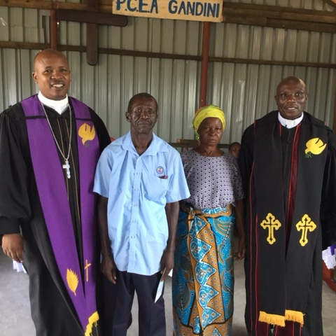 Mzee Piro and his wife standing between the  Pwani Presbytery Moderator and the Parish Minister