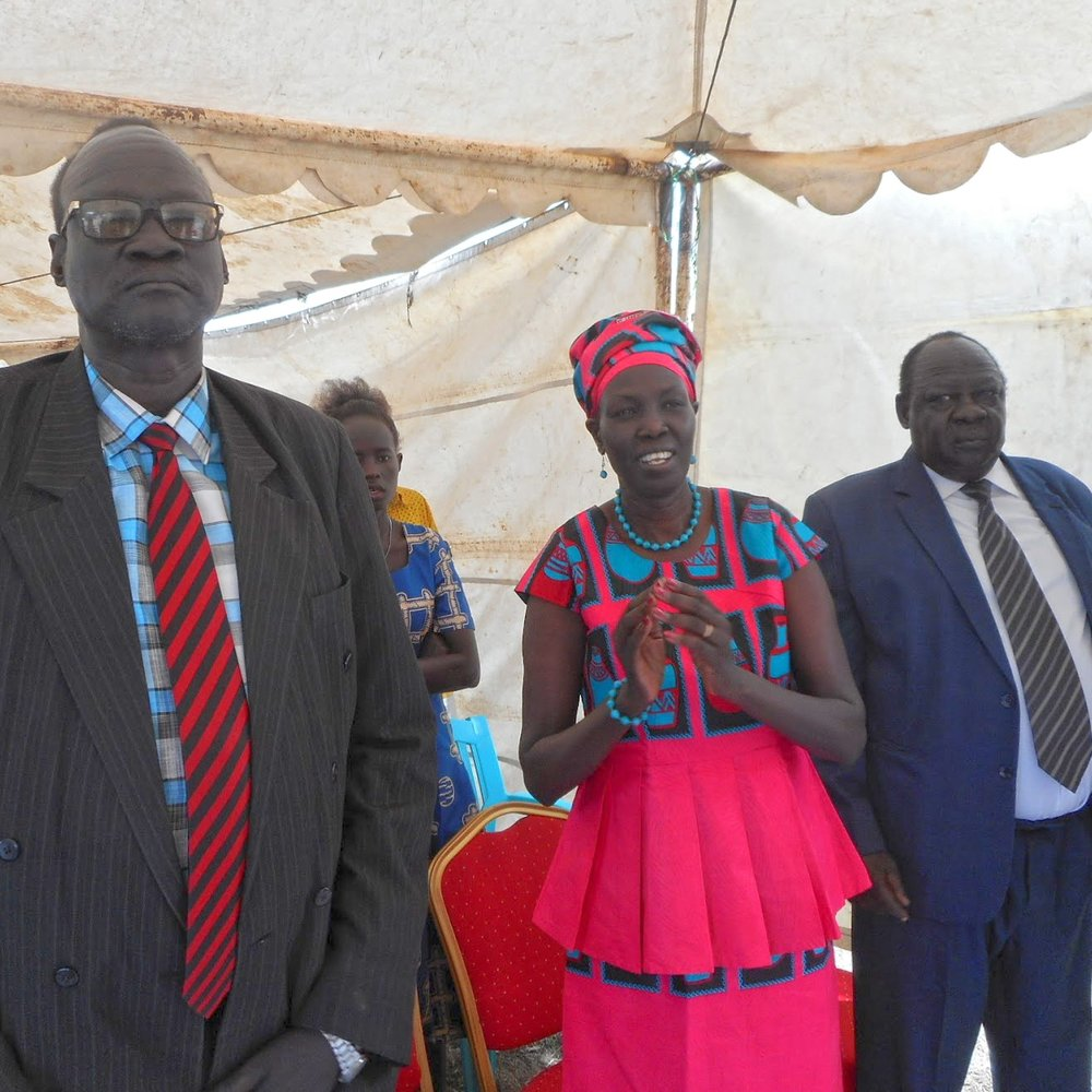 Rev. James Partap, Chairman of NTC, pictured with Honorable Minister Rebecca Joshua Okwaci and Honorable Minister Yien Oral Lam.