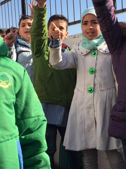Refugee children sing for us