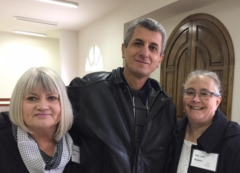 Marilyn Borst (left) and Julie Burgess (right) with Eli the poet (center)