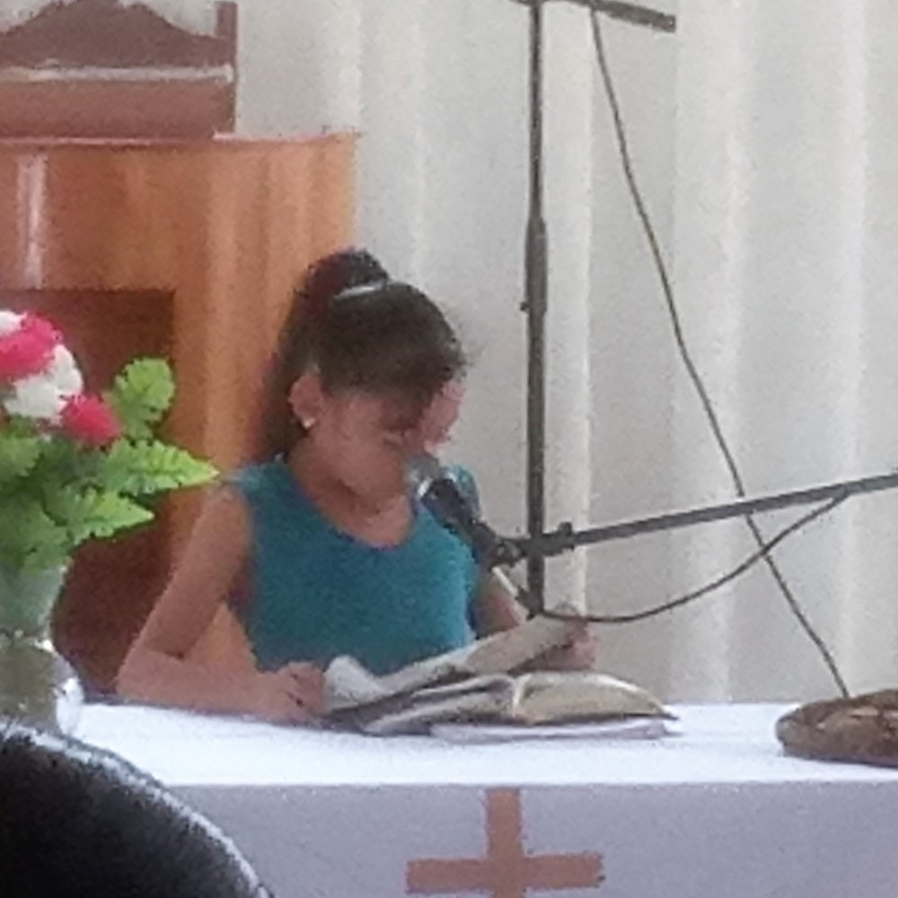 A young girl leads singing at Congregación El Sinai in Xpujil, Campeche