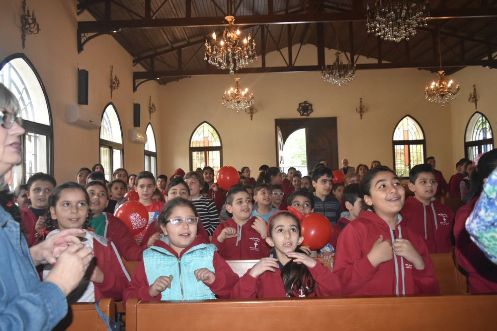 Aleppo Church Sunday school kids sing for us in welcome.