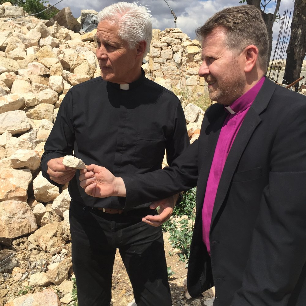 Rev. Jim Wood receives a stone of the old Aleppo church from Rev. Ibrahim.