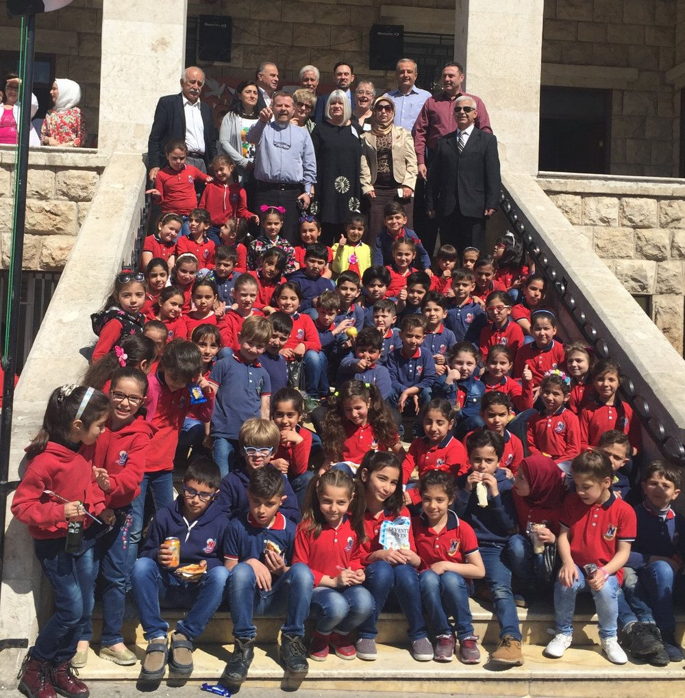 Outreach team on the steps of the New Generation School, run by the the Evangelical Church of Aleppo