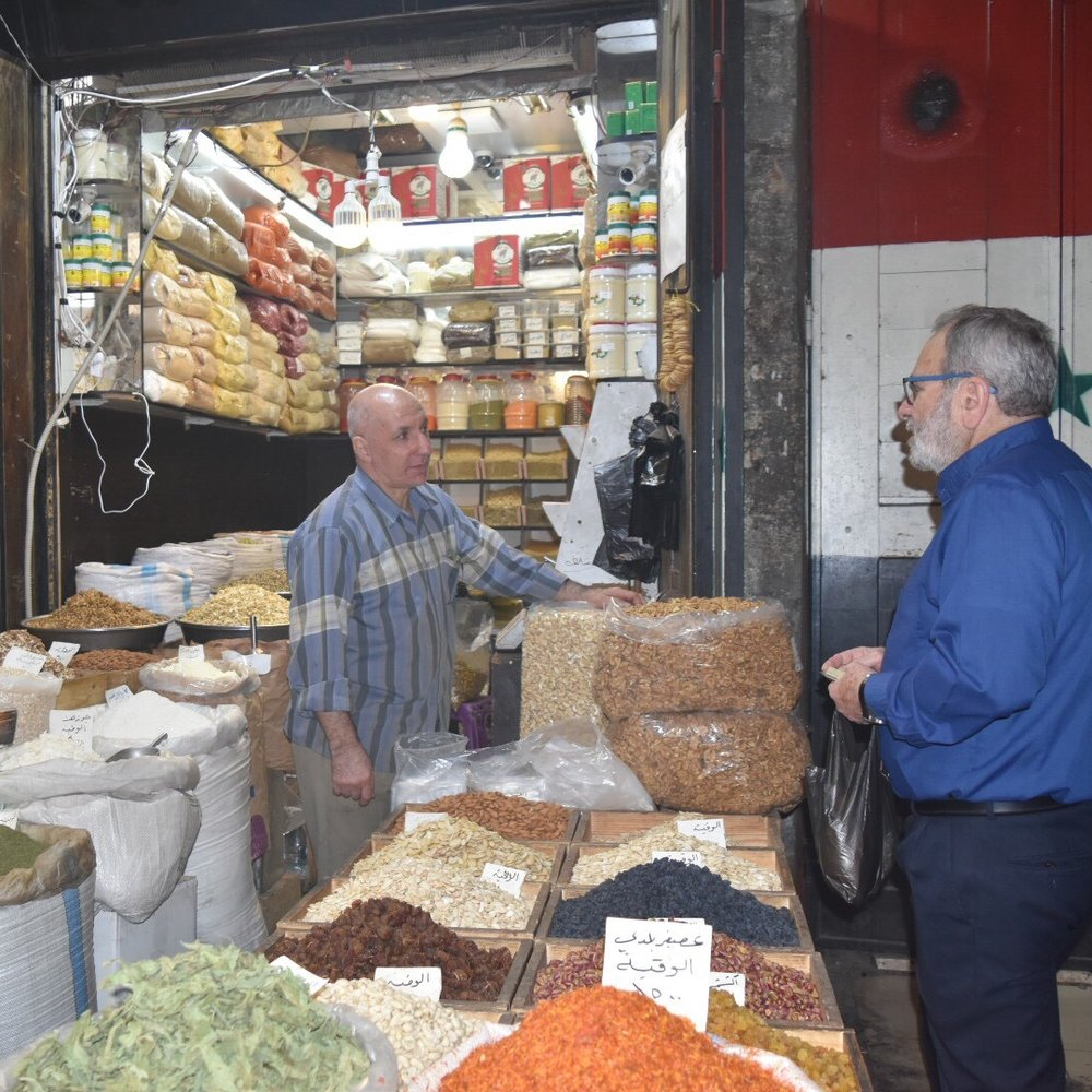 Nuhad Tomeh helps us purchase spices and nuts in the souq