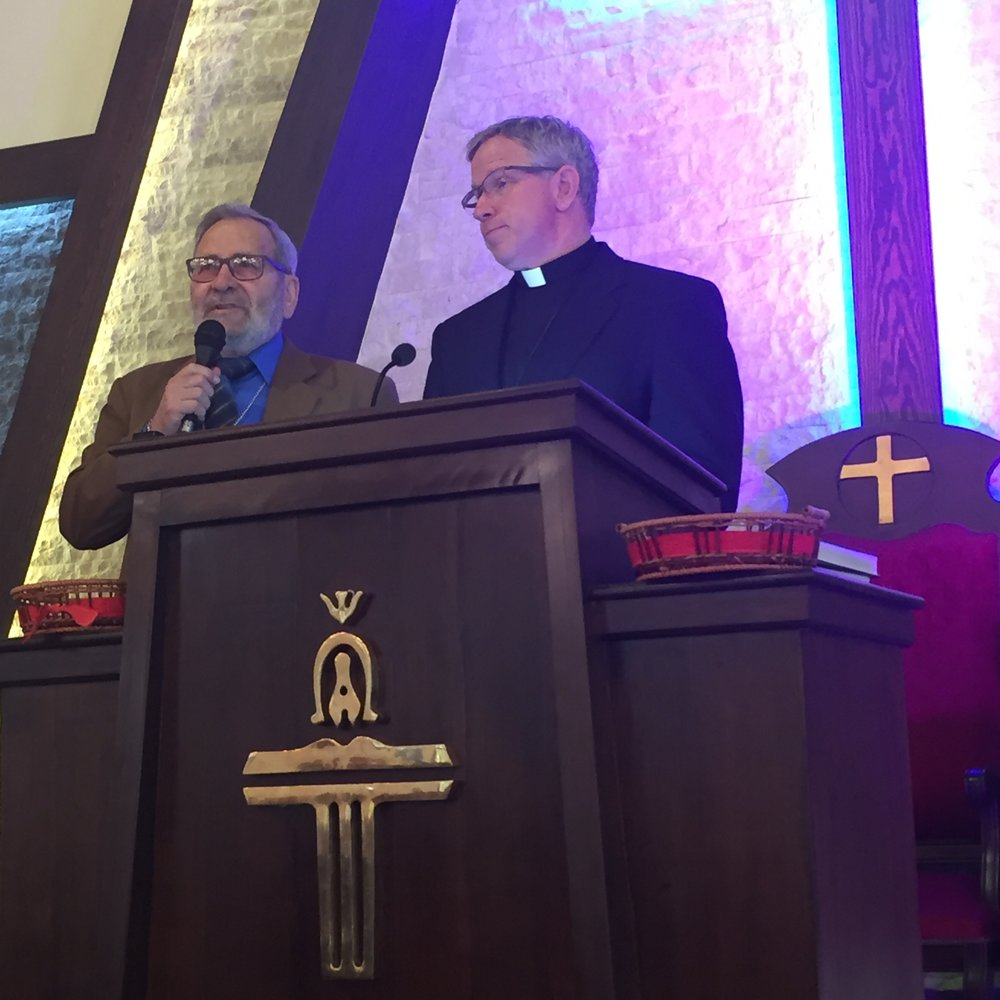 Rev. Tom Boone preaches  about Ananias while  Rev. Nuhad Tomeh translates