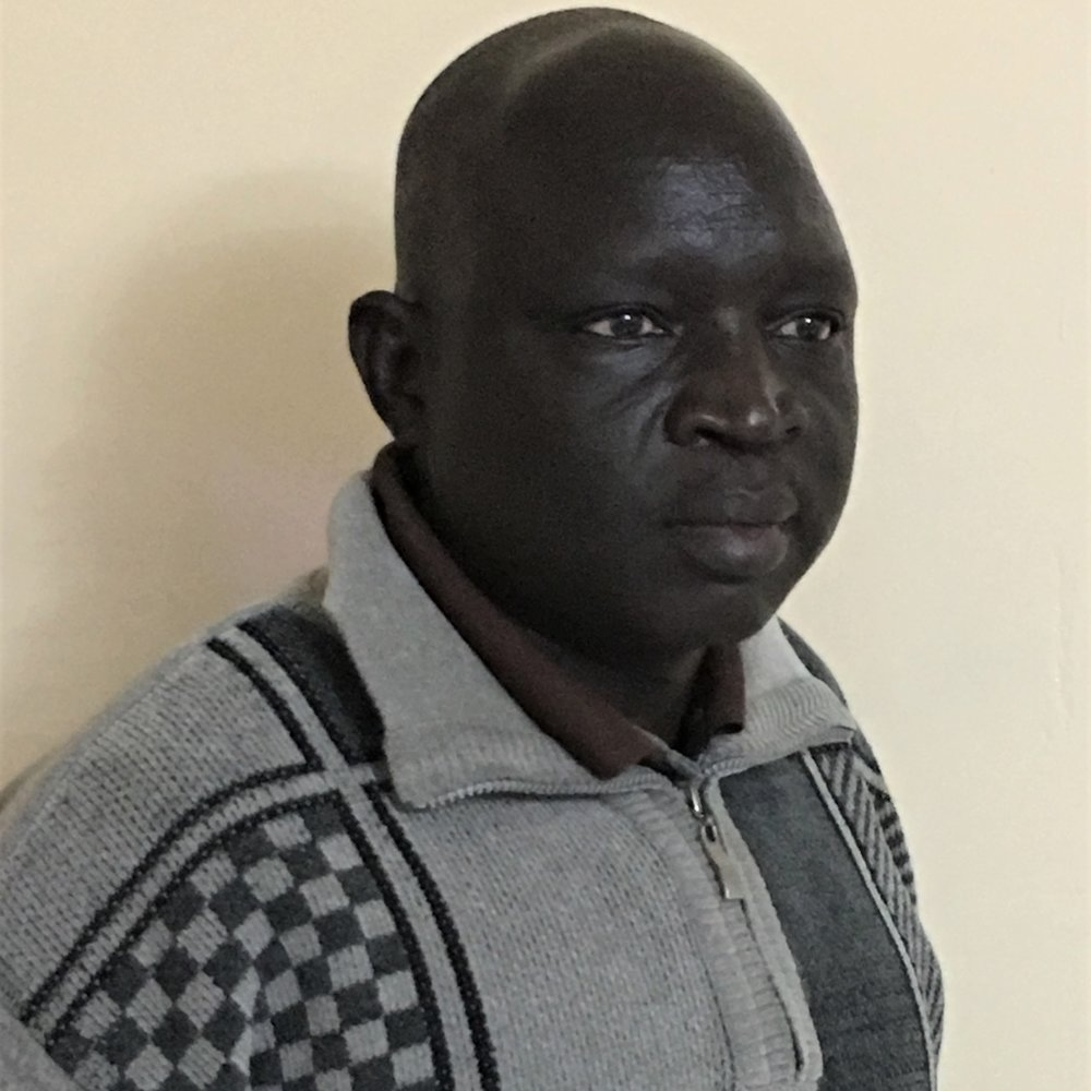 Dr. Thomas Doguande