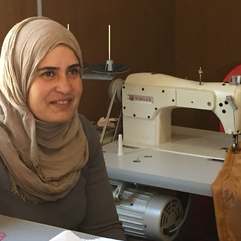 Refugee and IDP Appeal August 2016 update woman and sewing machine.jpg
