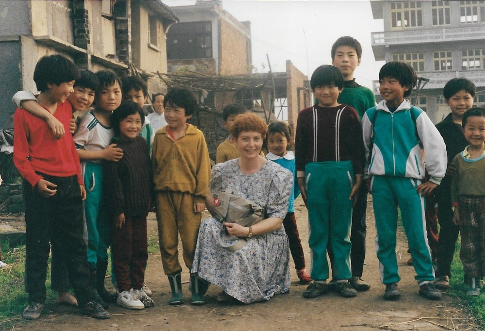 Pam Bowman with children on 1993 trip