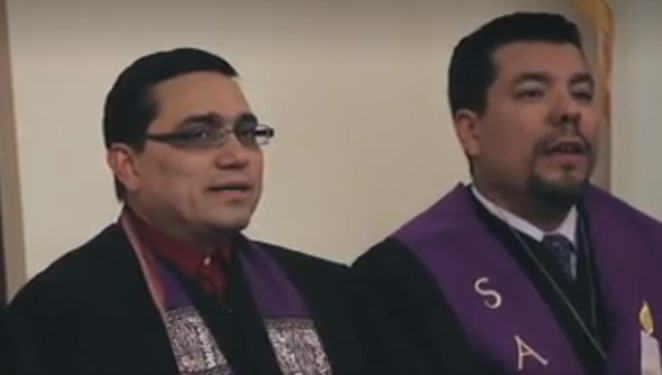Reverends Alfredo Delgado and Juan Sarmiento (now Presbyterian ministers) during a worship service in Los Angeles, California