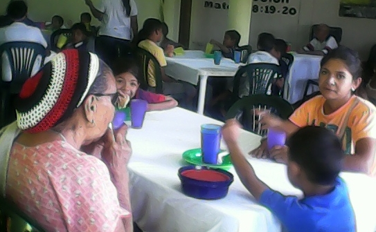 Some of the guests enjoying a meal at                    God Our Sweet Refuge Presbyterian Church in Maracaibo