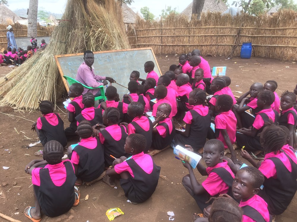Pre-school lessons in Nguenyiel camp. Uniforms are among those purchased with Outreach funds
