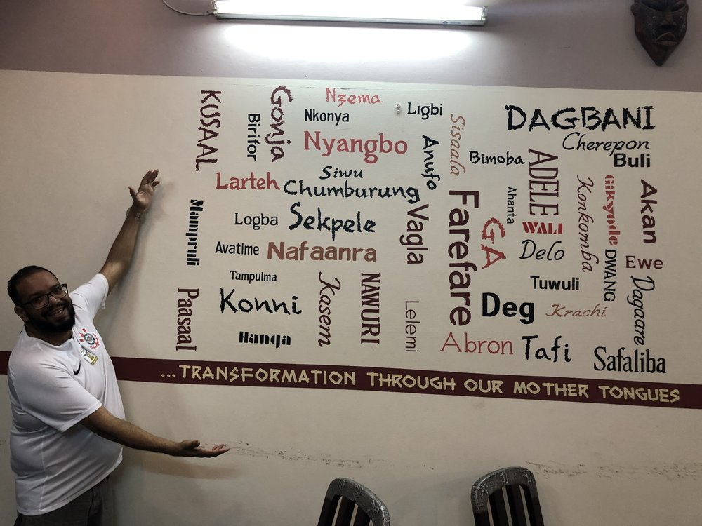 William Ramos at the Linguistic Institute of Ghana by a display of some of the languages in the country