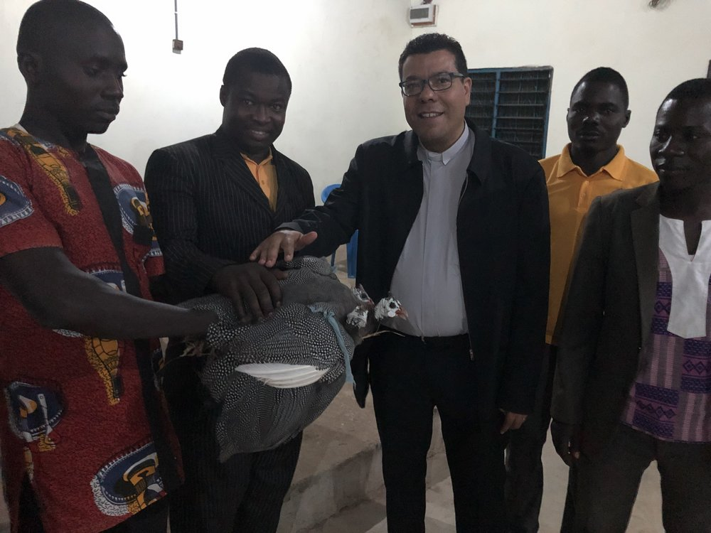 After worship at a church in Bawku presents Juan with two guinea fowl