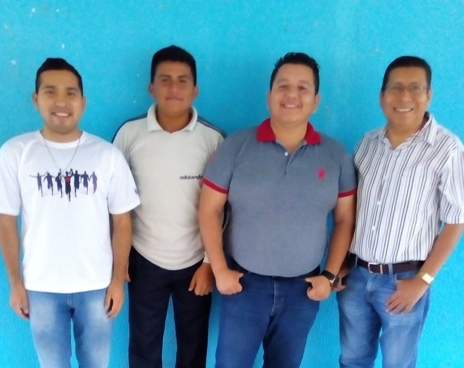 The dean of the seminary (right) with three  Sureste Seminary students.