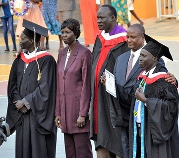 Gideon with (left to right) Rev. Santino-Principal, Honorable Rebecca Joshua,  Rev. James Par Tap-Chair of College Council,  Gen. Taban Deng Gai-First Vice President of South Sudan