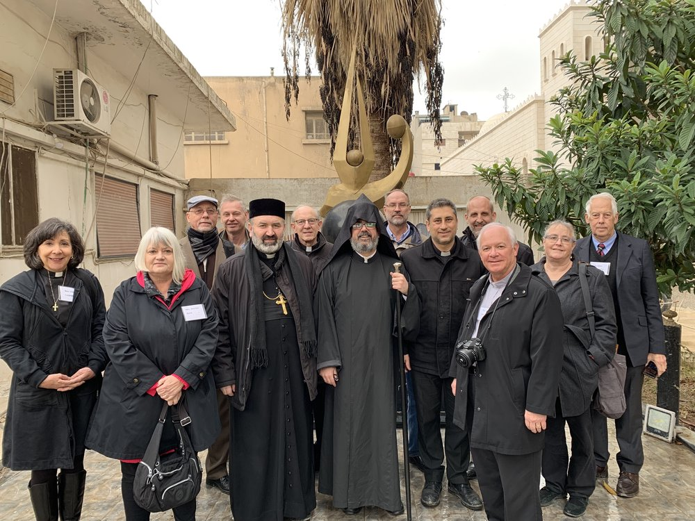 Outreach team with Syrian Orthodox and Armenian Orthodox clergy in front of the Armenian genocide memorial