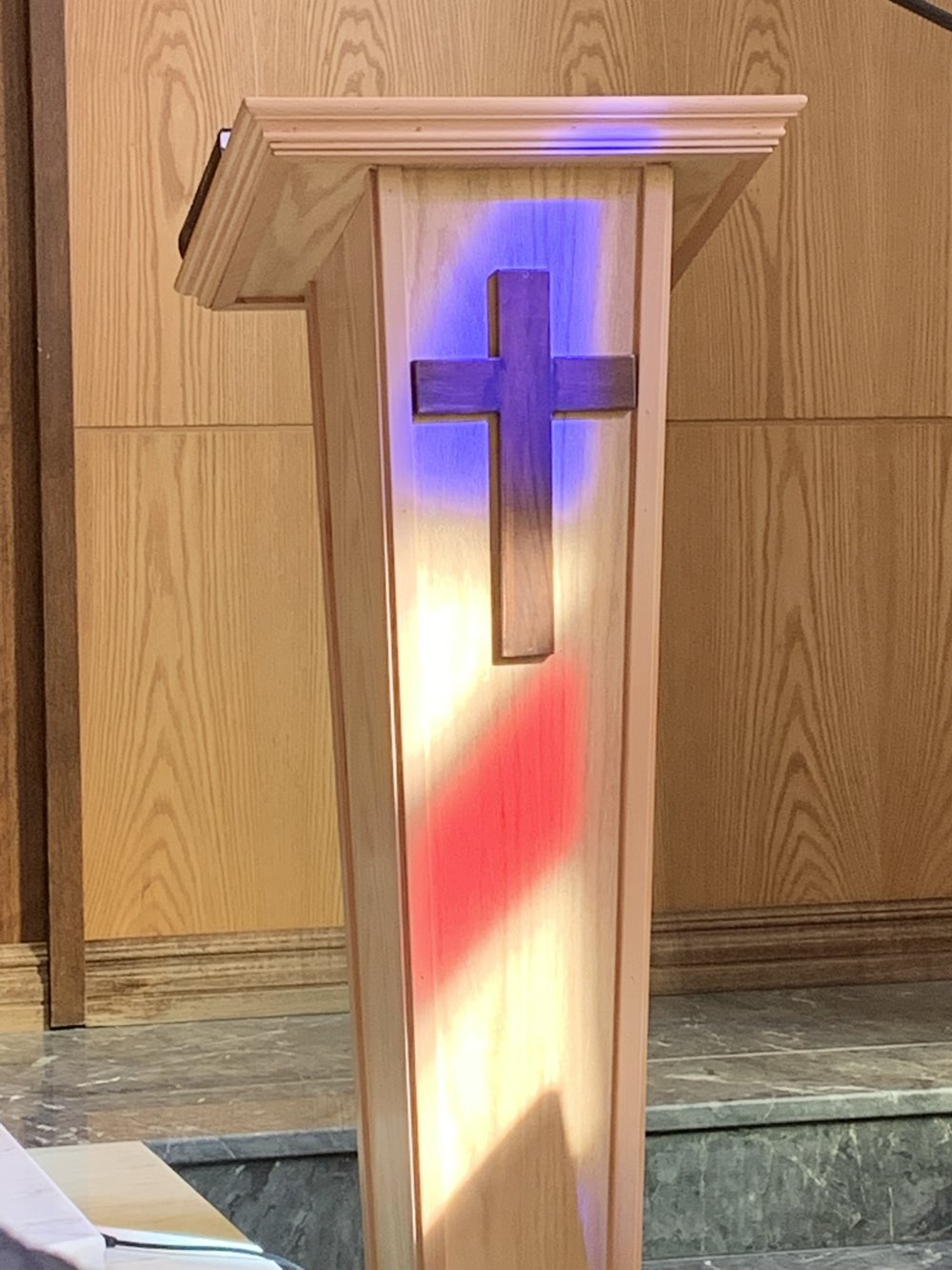 The light illuminates the pulpit to illustrate Rob's message