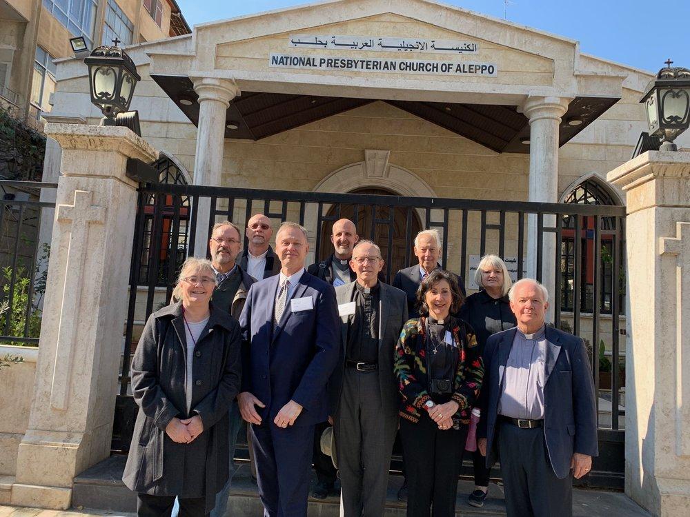Outreach team on the steps of the Presbyterian church in Aleppo