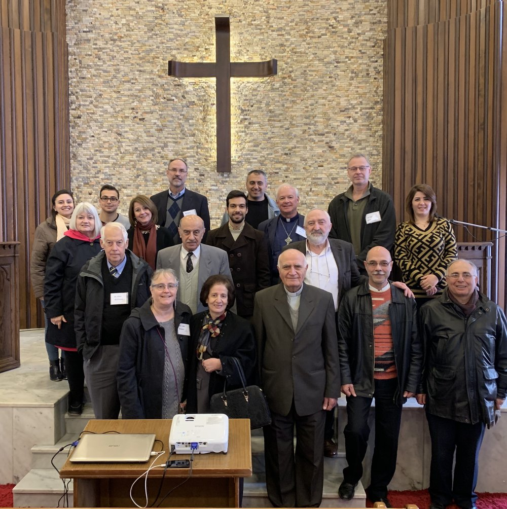 The Outreach team with pastor and leaders of Homs Church