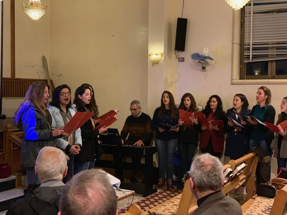 Yazdieh church choir with Pastor Elias Jabbour on the keyboard. His wife, Petra, is second from the left.