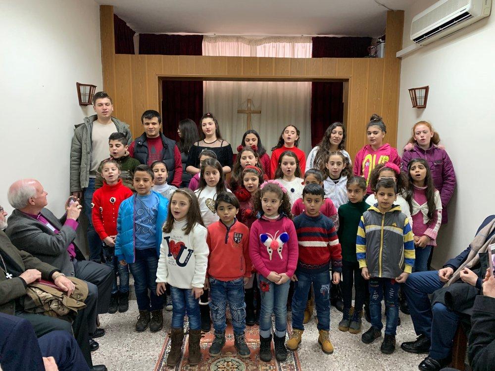 Youth and children sing to us at Banyas Church.