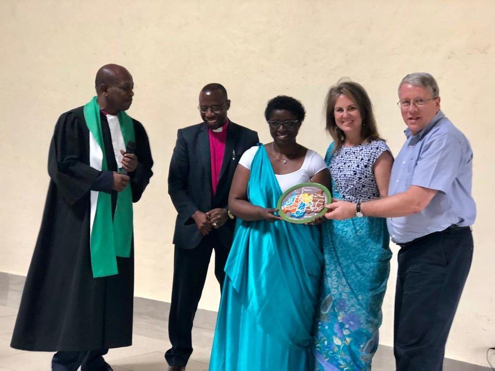 Receiving a gift from the congregation (Rev. Ndagiro & Rev. Bataringaya)
