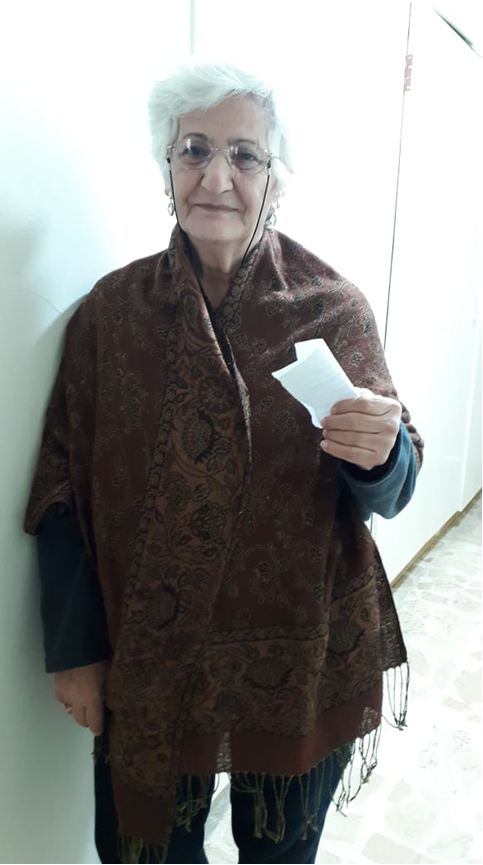 Refugee IDP Appeal March 2019 woman with voucher 2.png
