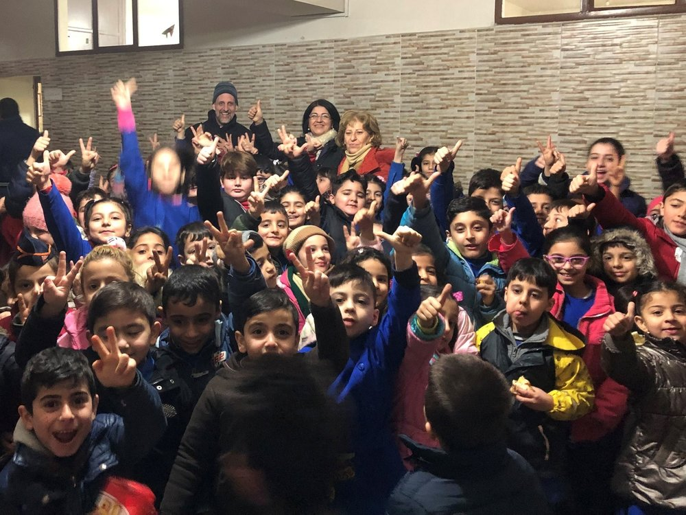 That is Mike waaaaay in the back behind this  sea of children at Qamishli school
