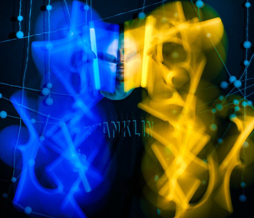 Self portrait with glow sticks.