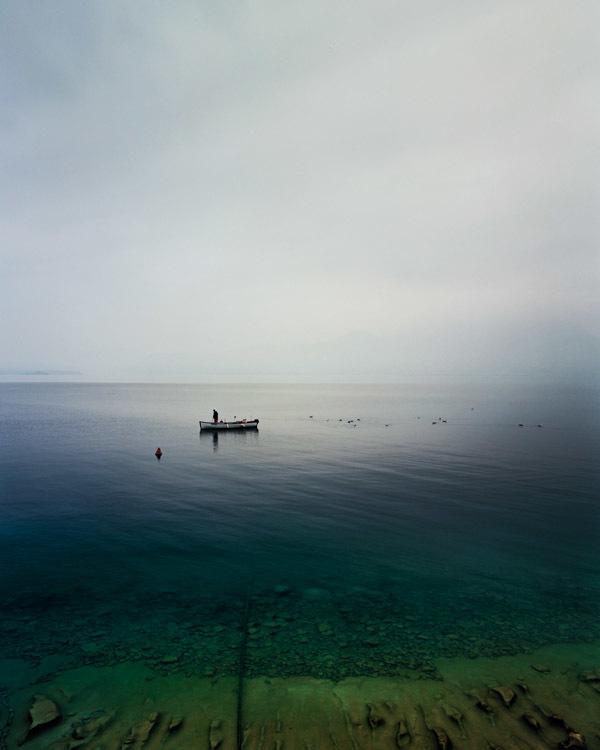 Fisherman. Lake Garda.