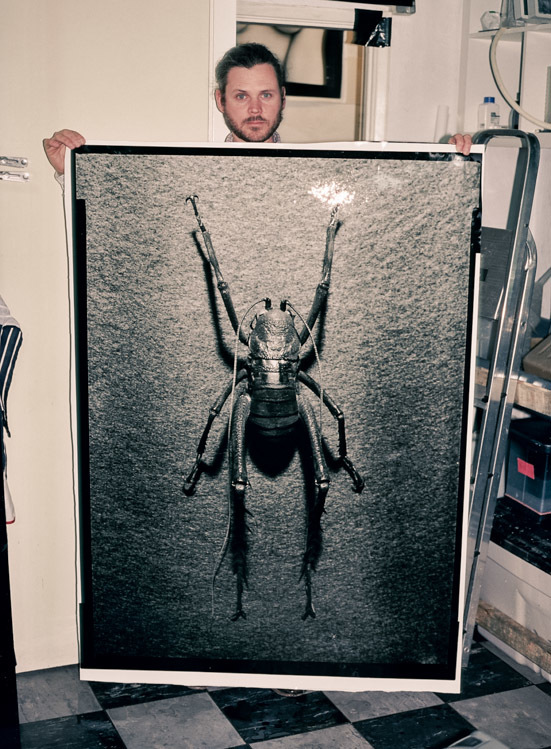 Me and my darkroom print of the Giant Weta.