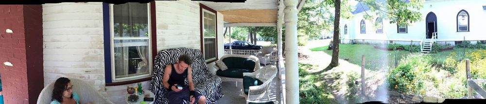 A panoramic shot of the NACL Retreat House and Theatre, with Letter of Marque Cap'n Welland Scripps and our dramaturg Lynde Rosario relaxing with morning coffee before rehearsal. Thanks Andrew Borthwick-Leslie for the photo!