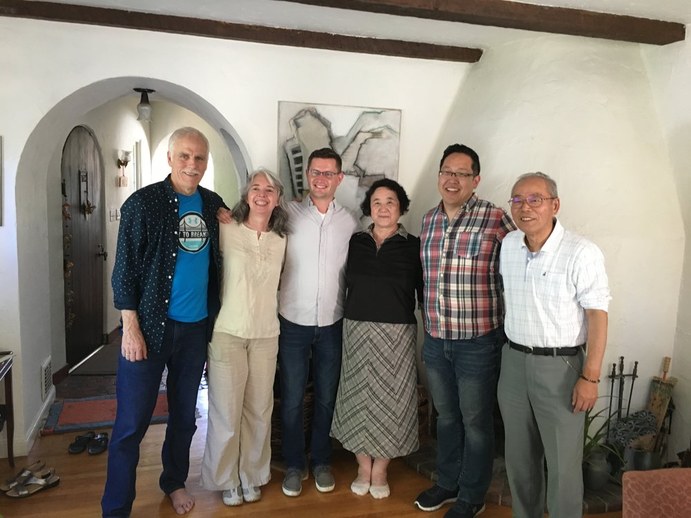 A photo with Akiko (to my left) and her husband Ken'ichi (to my right) at translator Frederik L. Schodt's house (far left).