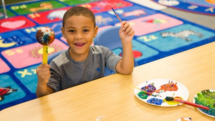 """A Cleveland Metropolitan School District pre-K student participating in the Children's Museum of Cleveland sponsored classroom visit titled """"Planets of the Solar System."""" (Copyright: WASF, 2017)"""