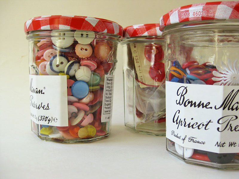 Bonne Maman jars are great for storing buttons, beads and other knickknacks