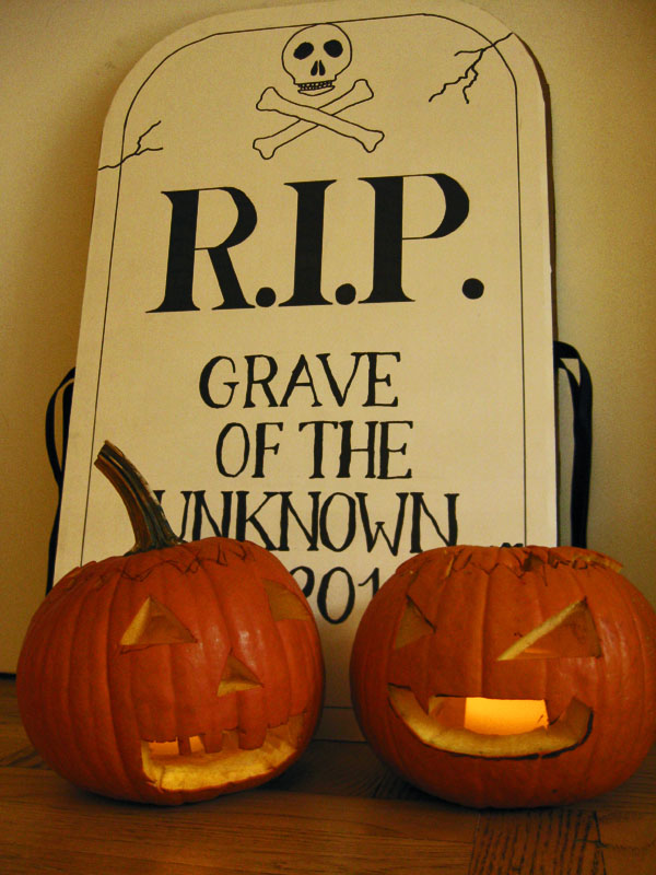 T's pumpkin on the left, W's pumpkin on the right, and the gravestone costume.