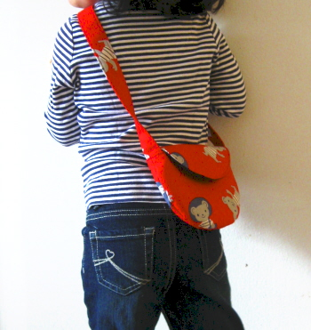 T modeling a toddler bag in 2008 (age 4)
