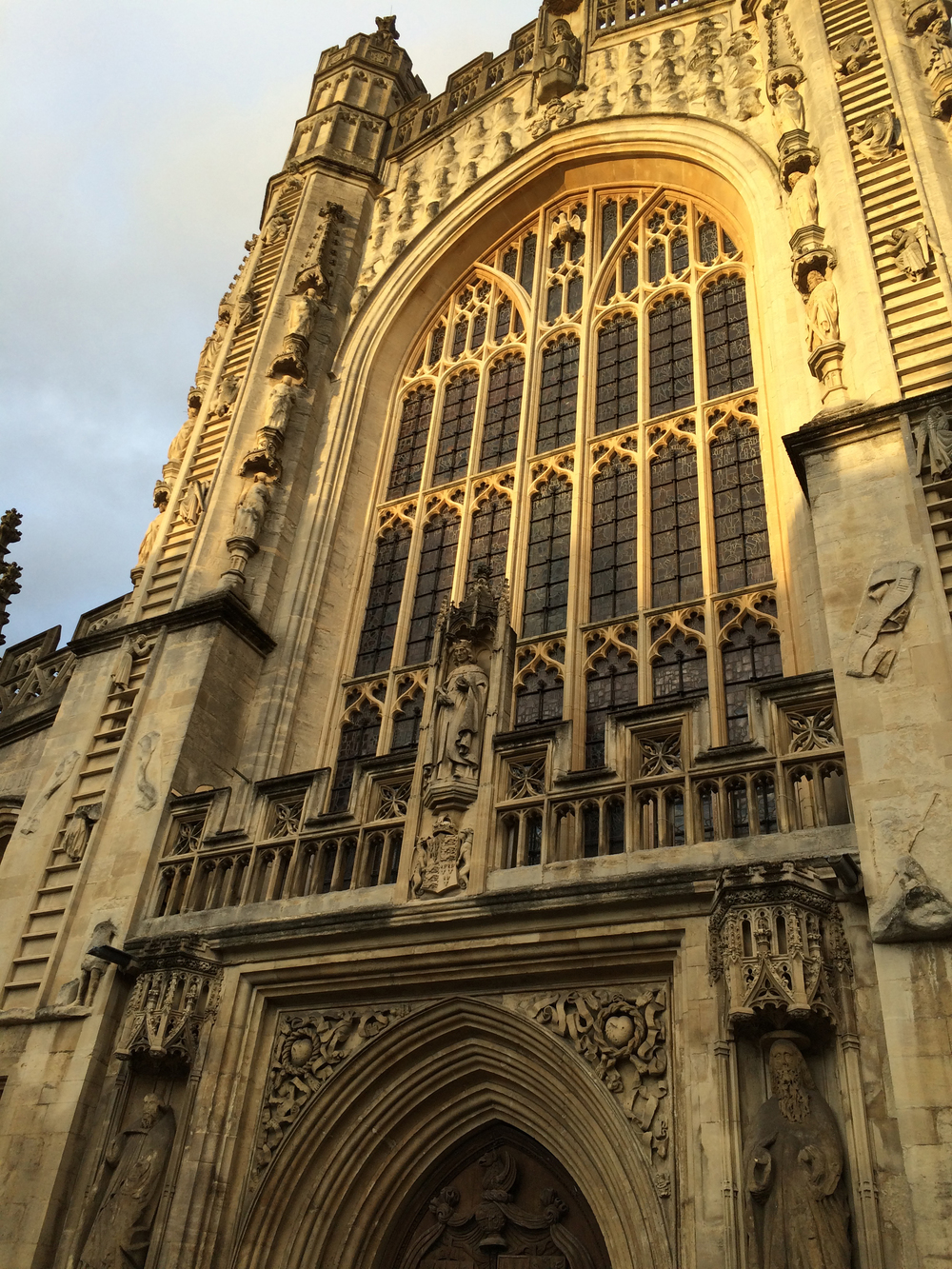 The facade of Bath Abbey was golden in the twilight.