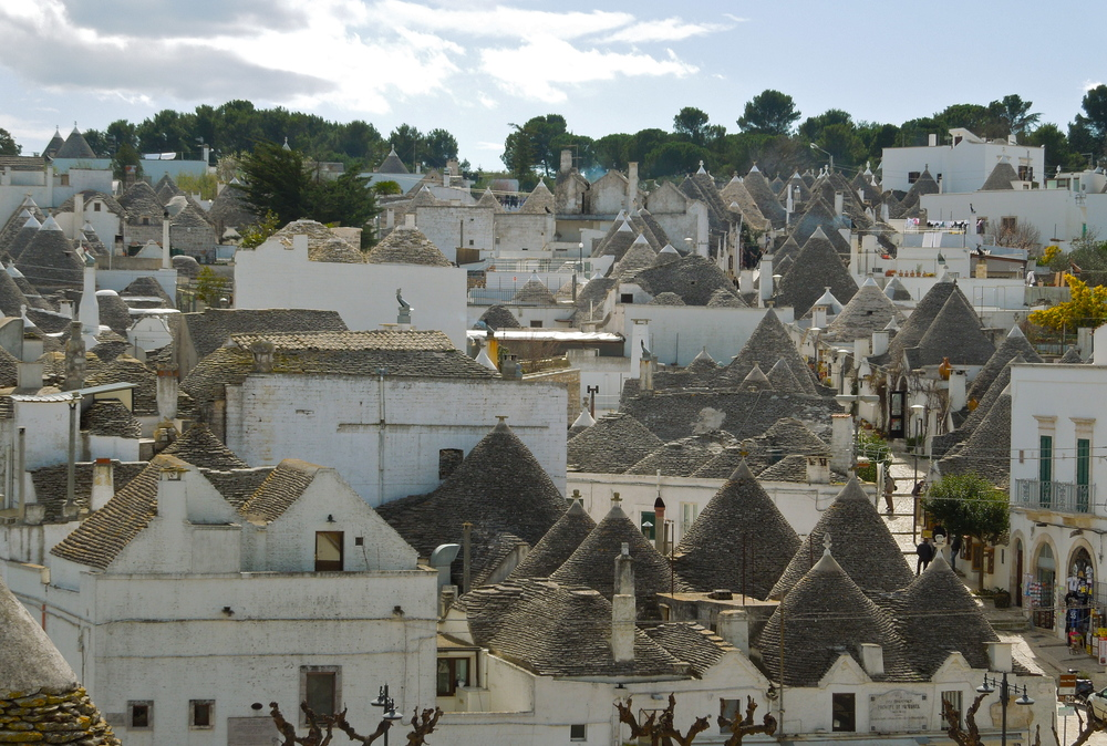 A Collage Of Nine Photographs Of The Traditional Trulli Houses ...