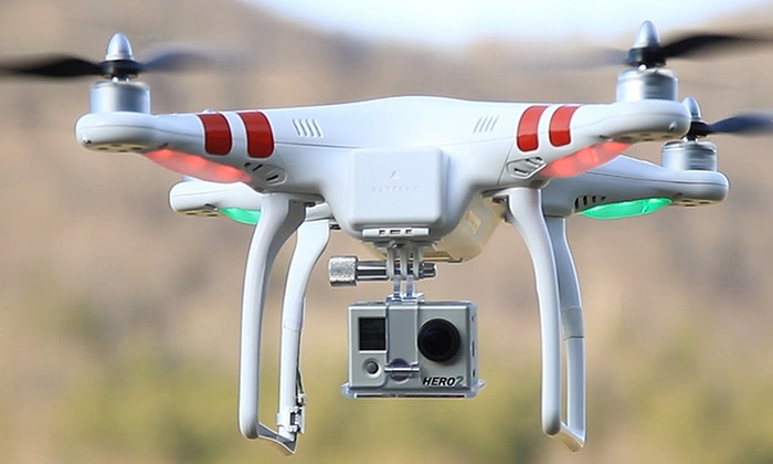An original Phantom 1 drone by DJI, with an attached GoPro Camera.