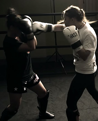 Fight like a girl:       PHAS3 offers kickboxing and fitness classes for women and girls.