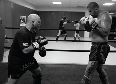 PHAS3 Coach Ben Brown (left) training with 7-time World Kickboxing Champion Rick Cheek