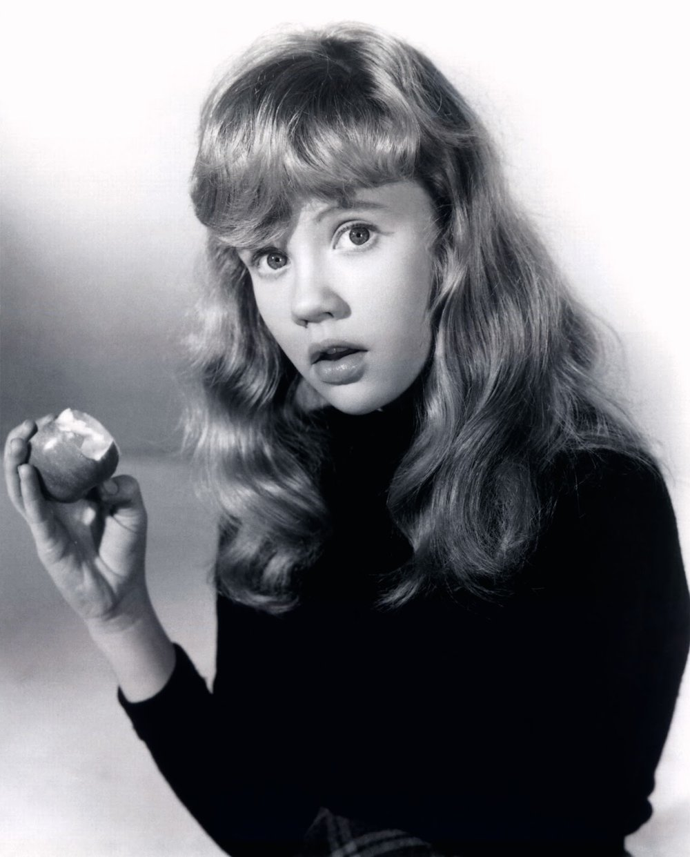Hayley Mills with an apple.