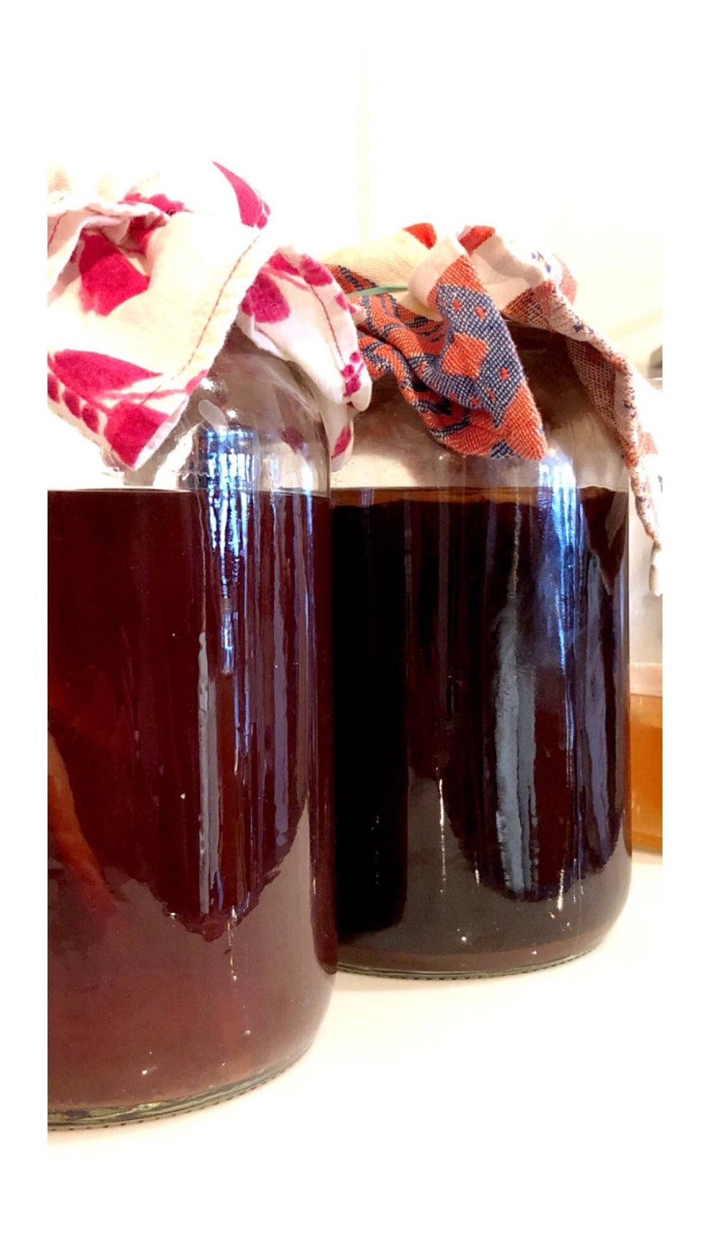 Rose kombucha and Coffee Kombucha in their bulk ferments