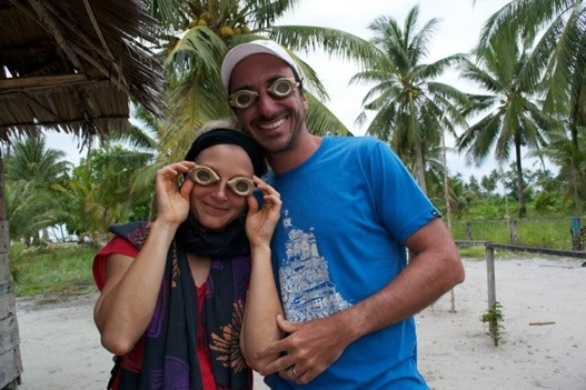 Tanja & Fred model the traditional Indonesian goggles they bought in Saukabu
