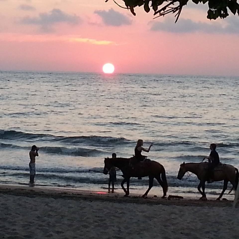 kaya and august on horseback at sunset.jpg